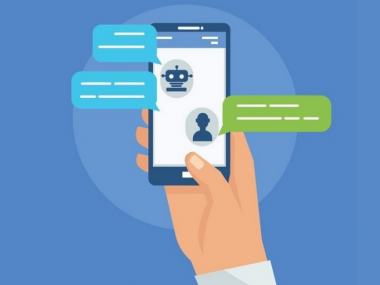 Conversational SMS Messaging in Debt Collections Illustration of hand holding a phone with speech bubbles with icon for person sending a messaging and chatbot