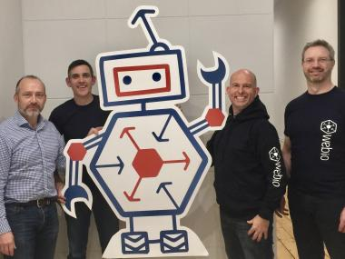 Webio Team pictured with an animated chatbot as Webio 's selection into Google for Entrepreneurs AI and Machine Learning Programme announced